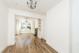 Redecorated four double bedroom family house to let with a private garden in Parsons Green.