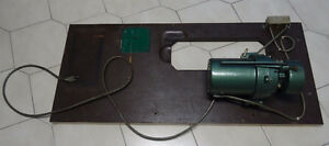 Sewing table and motor