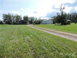 1/4 Sect. with house, shop, barns in Bay Tree Area