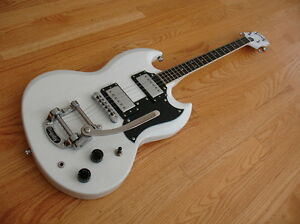 White Astrojet 4 string electric tenor guitar with bigsby