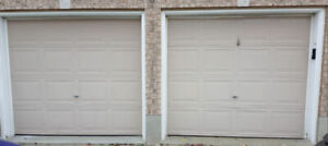 2 Used Garage doors for sale with new hardware $200.00