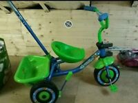 Green 3 wheeler with parent handle