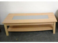 Light wood coffee table inset with glass