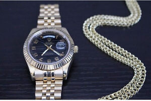 New Rolexs and chains etc