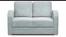 Sofa - 2 seater COMFORTABLE sofa . EXCELLENT under STORAGE option. Used in good condition.