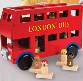 Wooden Red Bus large toy with nine wood figures.