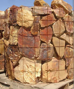 Large boulders in rust, orange, or beige colour for front yard