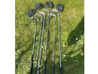 Golf clubs with covers