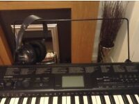 Casio electronic keyboard with stand and headphones