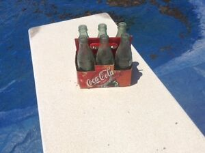 6 Coca Cola bottles with case