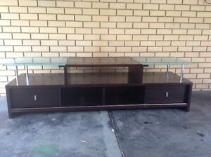 Solid dark wood TV entertainment unit Carine Stirling Area Preview