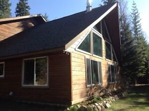 3 acres, newer Cedar home, & large shop, in the Slocan Valley