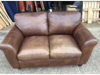 Pair of brown leather two-seater sofas