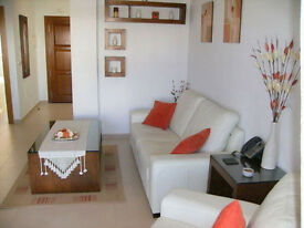 A LOVELY 2 BEDROOM 2 BATHROOM RENTAL OVERLOOKING GARDENS AND A 35 METRE POOL IN SUNNY MURCIA SPAIN