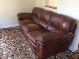 Two seater/three seater soft dark brown leather sofas with matching ottomans
