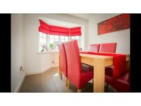 Light oak extending dining table with 6 faux leather red chairs