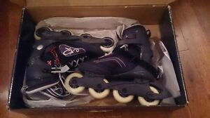 Moving sale: woman Roller blades like new in box + protectors