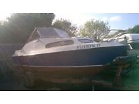 19ft Shetland 570 on trailer with 85hp suzuki power trim and tilt