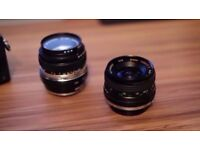 Two Vintage Prime Lenses with OM Adapter