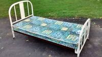 Vintage bed with wheels.  Make me an offer!!