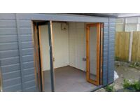 Brand new semi insulated art studio garage /storage/workshop with garden and electric available.l