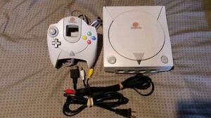 dreamcast ,1 remote,1 memory card and 4 games
