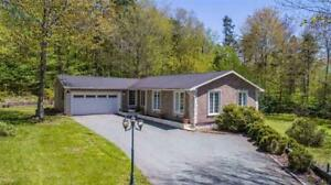 Contemporary bungalow located in Wellington! 14 Pine Oak Drive