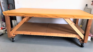 Table solid on wheels for workshop for sale. Only $100