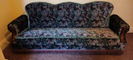 FREE SETTEE CONVERTS TO BED WITH STORAGE.