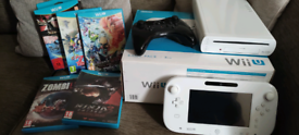 Wii U console, Pro Controller and 6 games.