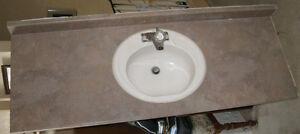 2 Bathroom Counter Tops with Sinks and Taps