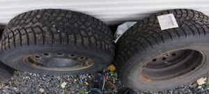 Studded winter tires on rims with matching lug nuts