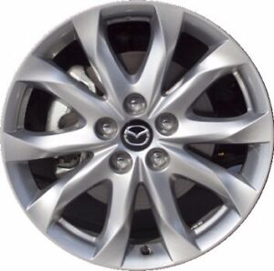 "Mazda 3 standard 18"" rims for sale new in box"