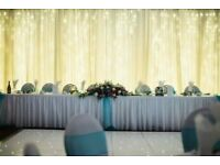 100 CHAIR COVERS & BOWS & FAIRY LIGHT BACKDROP £300
