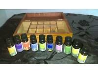 X10 Essential oils with carved wooden Box. £20