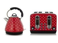 Matching red and white polka dot kettle and toaster
