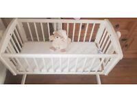 white swinging crib