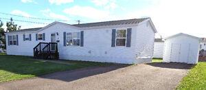 Mini Home for sale in PINE TREE VILLAGE!