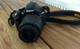 Nikon d3200 dslr digital camera and tripod
