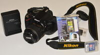 Nikon D5100 with lens, memory card, remote, and screenprotector