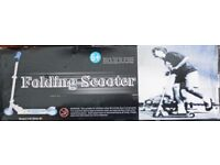 New Folding Scooter in box has not been used.