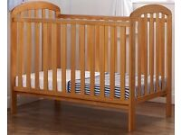 Solid pine baby cot in very good condition