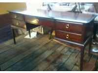 A decent dark wood side board or possible dressing table