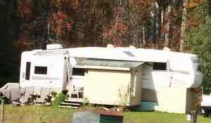 Beautiful 36 foot Fifth Wheel with winter package & 3 slide outs