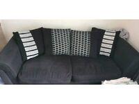 Two black large sofas