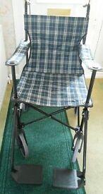 light weight blue tartan folding wheel chair.