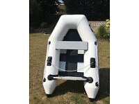 Inflatable dinghy, fast little boat with a 2.3hp Honda outboard motor