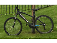 B-twin mountain mans or womans bike 18 speed