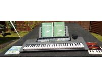 Yamaha EZ-200 Portable Keyboard with 61 Full Zize Lighted Touch-Sensitive Keys