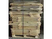 Pallets of wooden planks and crate sides